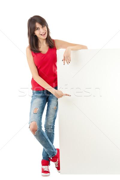 Girl holding a long vertical white banner Stock photo © grafvision