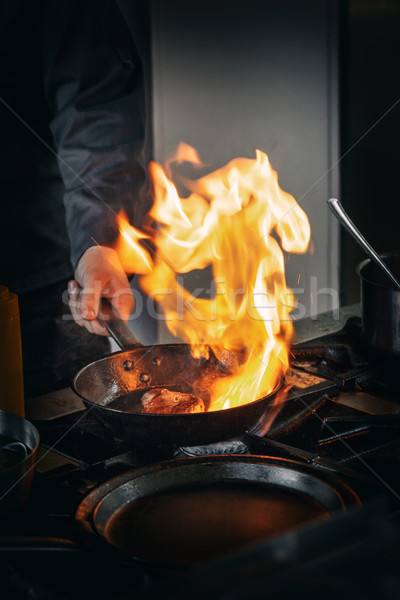 Professional chef in a commercial kitchen Stock photo © grafvision