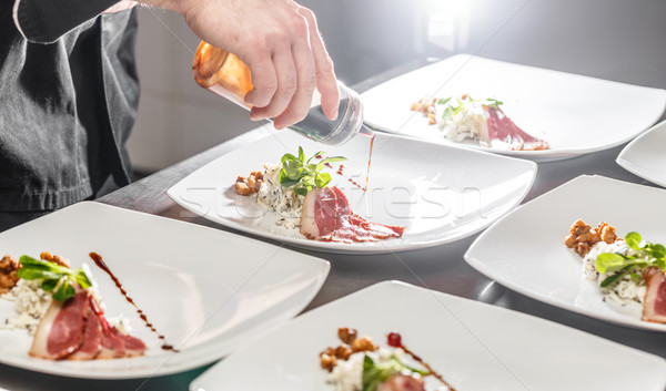 Chef decorating appetizer plate Stock photo © grafvision