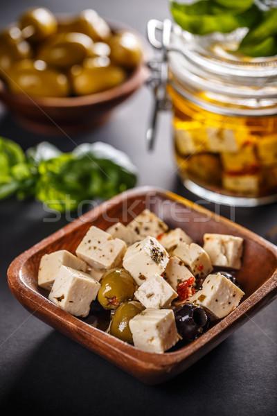 Marinato formaggio di capra oliva semi formaggio olio Foto d'archivio © grafvision