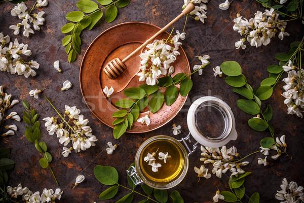 Jar of acacia honey Stock photo © grafvision