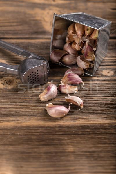 чеснока гвоздика прессы деревенский продовольствие Сток-фото © grafvision