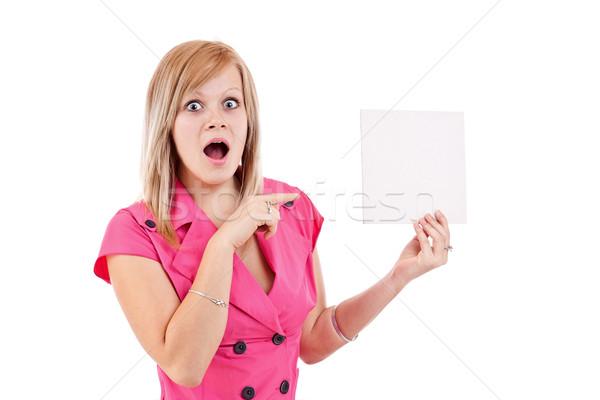 Genç kadın işaret boş kart portre şaşırmış yalıtılmış Stok fotoğraf © grafvision