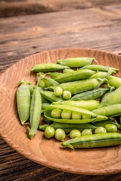 緑 エンドウ 木製 プレート 食品 背景 ストックフォト © grafvision
