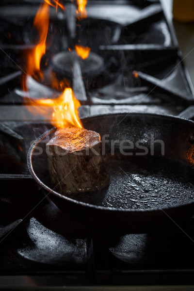 Piece of meat in fire Stock photo © grafvision