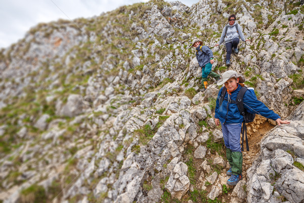 Mother and kids on mountain trek Stock photo © grafvision