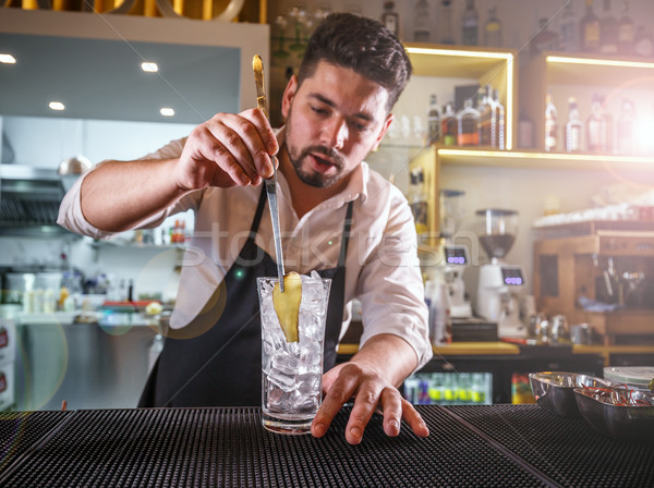 Bartender adding ginger into a glass Stock photo © grafvision