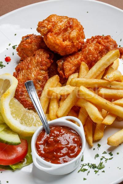 Frango assado pernas prato carne comer Foto stock © grafvision