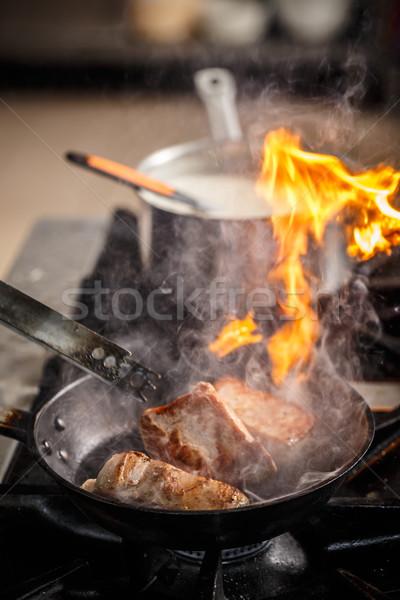 Chef cook in restaurant kitchen Stock photo © grafvision