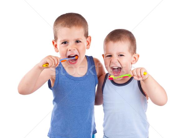 Stock photo: boys brushing his teeth