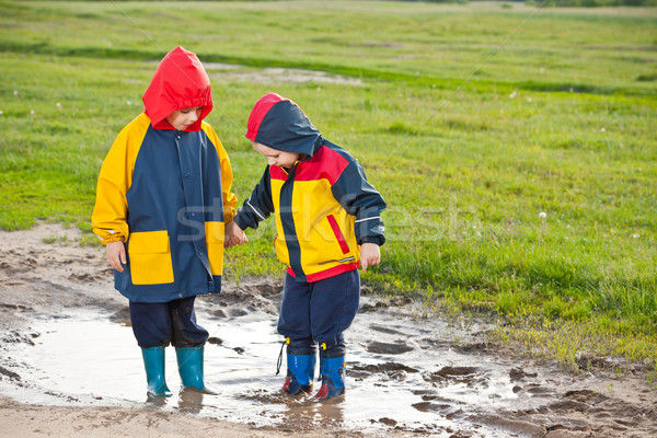 Stock photo: Boys  in the puddle