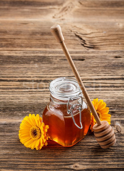 Honey with wood stick Stock photo © grafvision