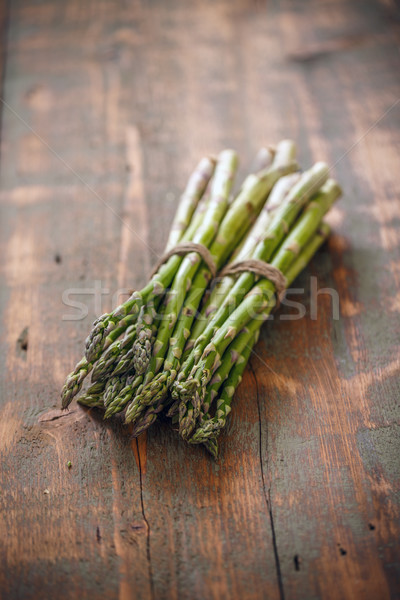 Stock photo: Bunches of fresh raw asparagus