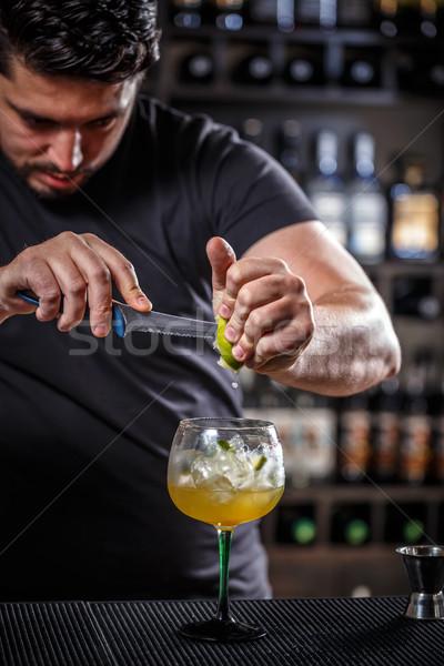 Bartender muddling lime Stock photo © grafvision