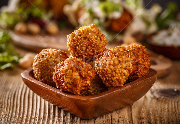 Falafel balls in wooden bowl Stock photo © grafvision