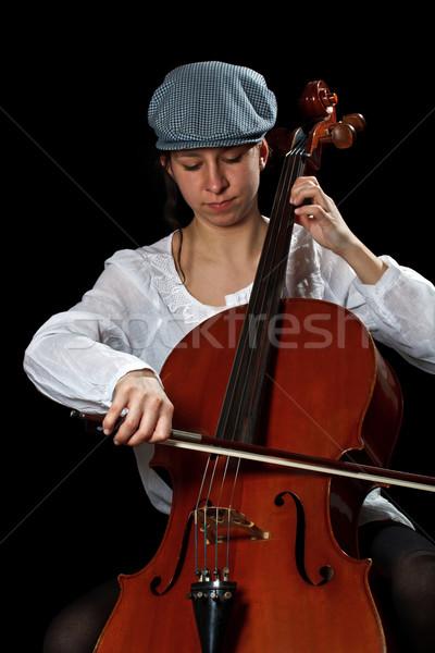 Młodych wiolonczelista posiedzenia gry wiolonczela czarny Zdjęcia stock © grafvision