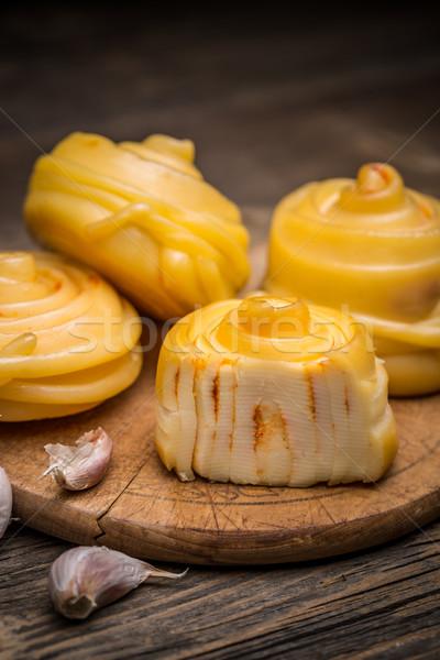 Twisted handicraft cheese  Stock photo © grafvision