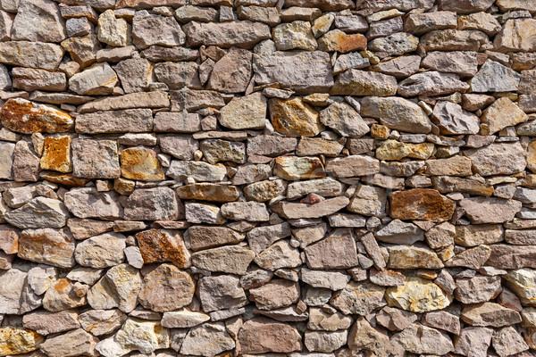 Irregolare screpolato effettivo muro di pietra pattern grigio Foto d'archivio © grafvision
