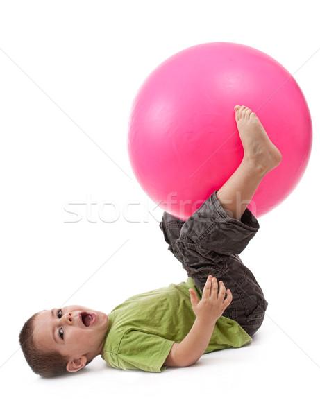 Stock photo: Little boy doing gymnastic exercises