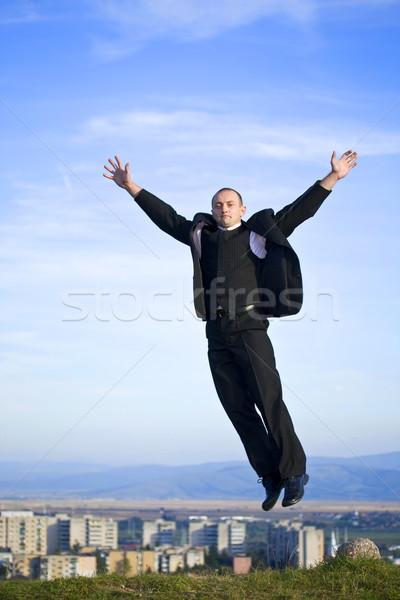 Liberdade homem saltando cidade negócio flores Foto stock © grafvision