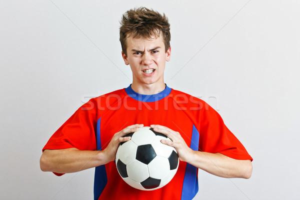 Zangado jogador de futebol bola esportes fundo retrato Foto stock © grafvision