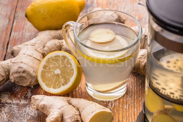 Foto stock: Jengibre · té · limón · mesa · de · madera · beber · taza