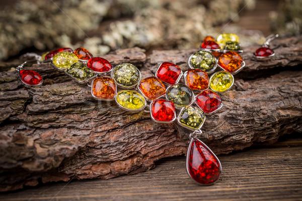 Színes kövek nyaklánc fából készült felület háttér Stock fotó © grafvision