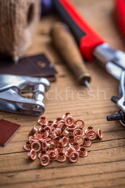 Brass eyelets and eyelet punch Stock photo © grafvision