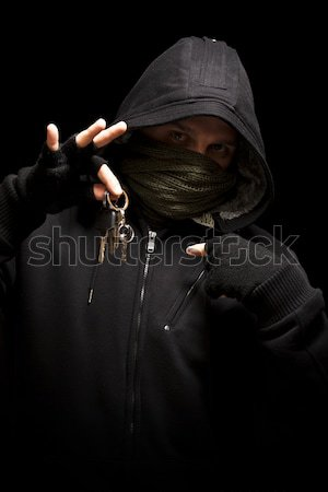 Dief pistool camera geïsoleerd zwarte man Stockfoto © grafvision