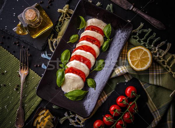 Lezzetli caprese salatası olgun domates mozzarella peynir Stok fotoğraf © grafvision