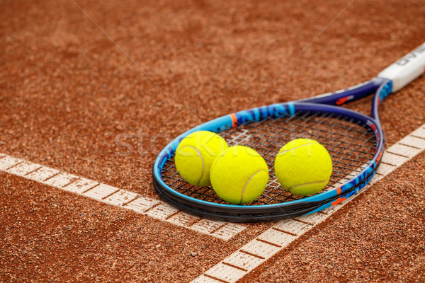 Tennis balls and racket Stock photo © grafvision