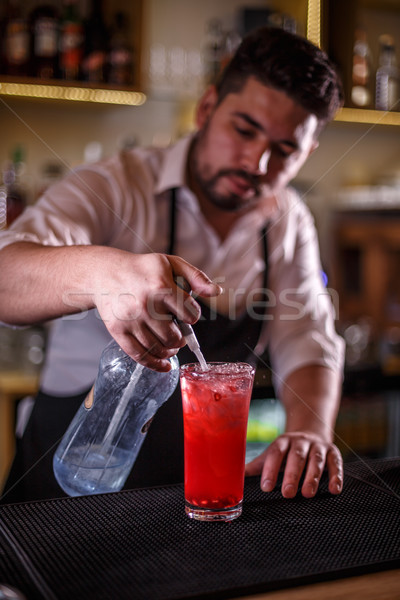 Bartender finishes preparing a cocktail Stock photo © grafvision