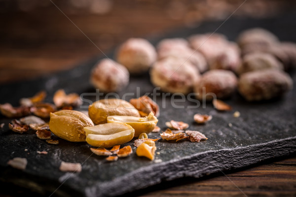 Gezouten pinda's zwarte noten gezonde Stockfoto © grafvision