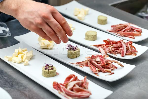 Male chef garnishing his dish Stock photo © grafvision
