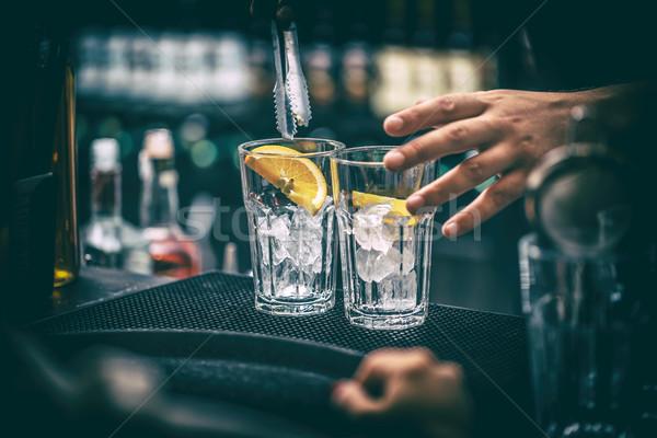 Barman cocktail barman oranje glas partij Stockfoto © grafvision
