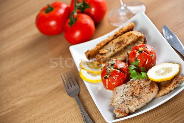 Varkensvlees kotelet tomaat plaat vlees Stockfoto © grafvision