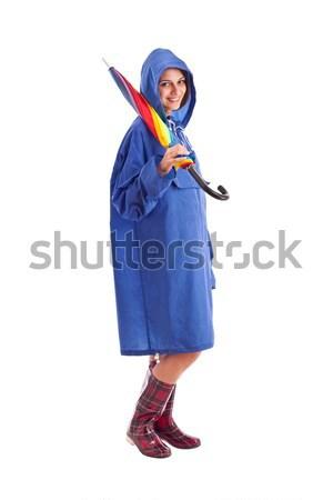 雨の 女性 青 レインコート 孤立した 白 ストックフォト © grafvision