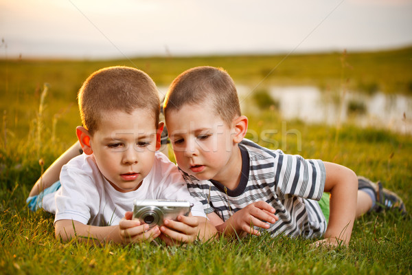 Stock photo: Two brother lying on meadow