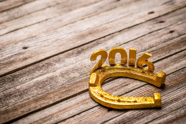 Text 2016 with golden horseshoe Stock photo © grafvision