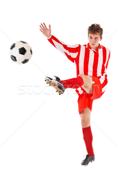 Soccer player kicking the ball Stock photo © grafvision