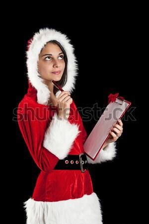 Woman wearing santa clause costume  Stock photo © grafvision