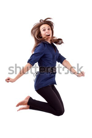 Happy young woman jumping  Stock photo © grafvision