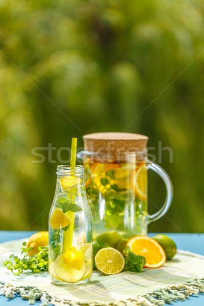 Lemonade pitcher with lemon Stock photo © grafvision