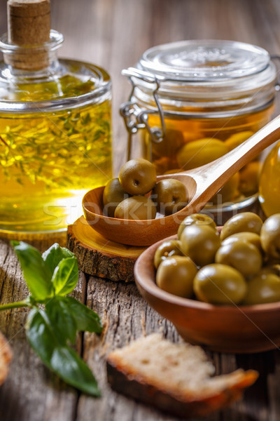 Green olives and olive oil Stock photo © grafvision