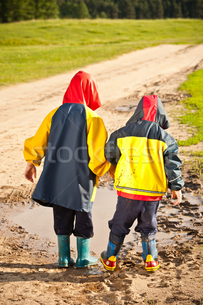 Brothers walking in puddles Stock photo © grafvision