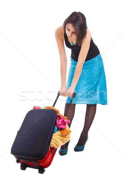 Woman dragging suitcase Stock photo © grafvision