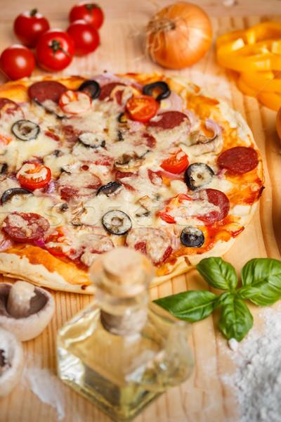 ペパロニ ピザ 木製のテーブル 表 肉 食事 ストックフォト © grafvision