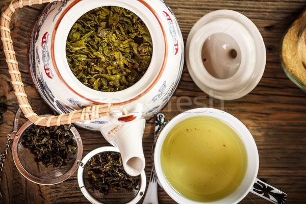 Teáskanna csésze zöld tea fából készült csoport szolgáltatás Stock fotó © grafvision