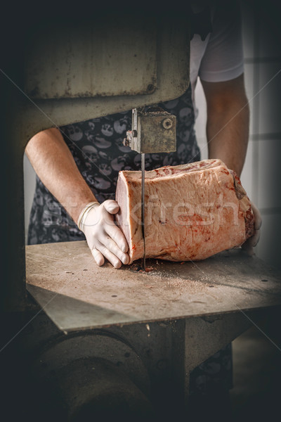 Butcher is cutting beef meat Stock photo © grafvision