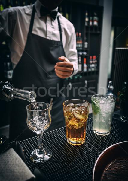 бармен работу три различный алкогольные напитки стекла Сток-фото © grafvision